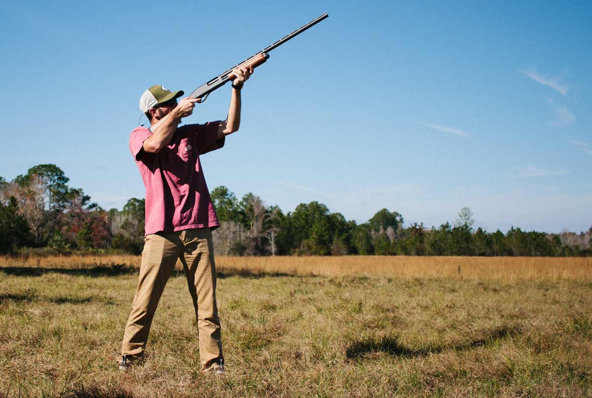 male,-shooter-engaged-in-sports-hunting-with-an-air-rifle-in-the-wild